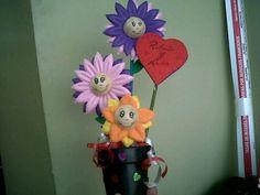 flores de fomi con carita