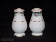 Noritake Rosslyn #4756 Salt & Pepper by Noritake Bone China. $16.99. Mint Condition, Never Used. Dimensions: N\A. Salt & Pepper - Predominately Blue And Cream Band On Off White Background With Gold Trim - Made In Japan