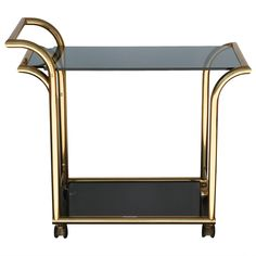 Modernist Italian Brass and Smoked Glass Bar Cart | From a unique collection of antique and modern bar carts at https://www.1stdibs.com/furniture/tables/bar-carts/
