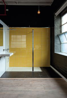 Another example of tiled wall in kitchen idea.  Love the yellow tiled wall