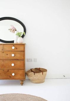 The black framed mirror over a rustic wood dresser with white knobs is gorgeous! The white vases tie it all in. Wood Dresser, Dresser As Nightstand, Stained Dresser, Home Bedroom, Bedroom Decor, Bedrooms, Turbulence Deco, Thrifty Decor, Living Room Flooring