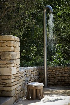 Outdoor shower and beautiful stacked stone wall. Outdoor Retreat, Outdoor Spaces, Outdoor Living, Small Spa Bathroom, Outdoor Bathrooms, Outdoor Showers, Spanish Home Decor, Pool Remodel, Pergola