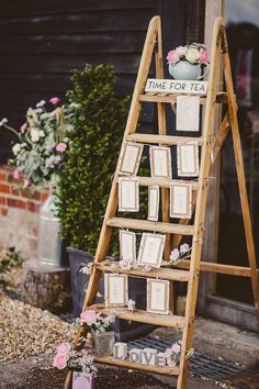 Image by - Lola Rose Photography - Rustic Step Ladder Table Plan - Sottero & Midgely Lace Wedding Dress and Rachel Simpson Shoes for a rustic country wedding in a barn with delicate pastel flowers. Bridesmaids in Navy & Groom in Grey Bartlett and Butcher Suit.
