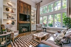 Spectacular family room with 18' ceiling, huge windows and gas fireplace with soaring wall of built-ins | 372 Winston Road, Oakville