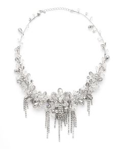 A vintage inspired necklace features white and silver cascades of crystal flowers creating a dramatic look. There is a lot of movement in this necklace giving it the ultra feminine charm.   $169.00