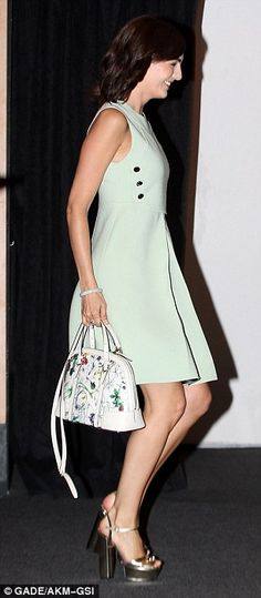 Retro re-imagining: For the event, Camilla wore a matching mint two-piece featuring a high necked cropped top with buttons on its sides with...
