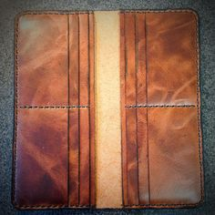 Handmade item, - Hand-Stitched with Black Tiger thread, - Distressed Brown leather imported from Germany, - 2 large pockets (under the card sections), 12 card slots, - 20 x 9.5 x 1 cm., - Made in Canada.  ☛ For Name/Initials engraving please order : https://www.etsy.com/listing/216452974/customization-fee-laser-engraved  ☛ This item ships FREE when ordered with another item : https://www.etsy.com/ca/listing/203183318/leather-cableearbuds-organizer