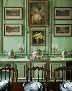 Gorgeous green walls and a curious portrait make this room quite intriguing.  ~Splendor