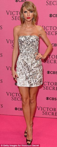 Ready for action: Taylor Swift was stunning in a strapless minidress before she hit the ru...