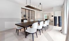 Kevin Reilly, Altar lamp,pale neutral palette dining room with suspended candle frame