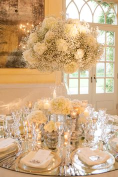 An incredible wedding at The Lost Orangery in Colerne. White hydrangeas, gypsophila (baby's breath) and lots and lots of candles!