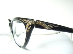 rhinestone studded cateye frames from the 1950s! beautiful shape to the frames, with snazzy swirling details carved into frames and sprinkled