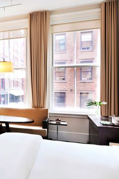 The rooms have an industrial-chic look achieved with oversized windows and metallic surfaces. #Jetsetter