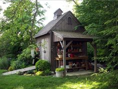 Love thw covered potting shed on the side of the garden shed.