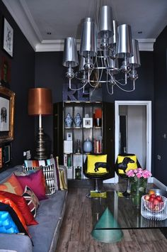 Playful throw pillows become the focus in this small, dark space