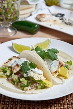 Cilantro and Lime Fish Tacos with Tomatillo Pico de Gallo Cilantro Crema and Avocado <3