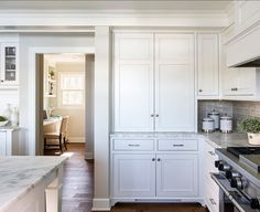 """White kitchen with Inset Cabinets - """"Benjamin Moore Winds Breath OC-24″ (walls) // BM Simply White on cabinets"""