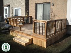 Simple deck with bench. Like the wooden skirting. Never seen that before.