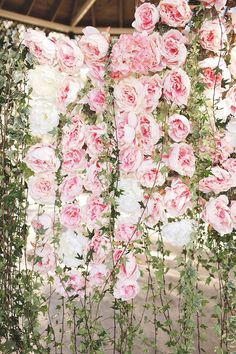For a photo backdrop | Community Post: 38 Prettiest Ways To Use Flowers In Your Wedding