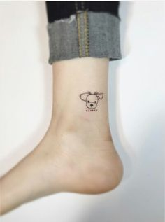 Cute !tiny dog tattoo ...want more ? Take a look in the gallery !
