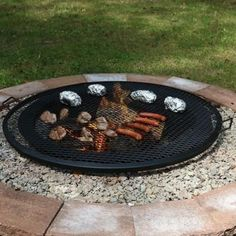 """This metal mesh cooking grate is a simple and efficient way to grill food on your fire pit. This grate is made with durable metal construction. 1 year manufacturer's warranty. 19""""- 19"""" diameter grate 22""""- 22"""" diameter grate 24""""- 24"""" diameter grate 30""""- 30"""" diameter grate 36""""- 36"""" diameter grate 37.5""""- 37.5"""" diameter grate- Out of Stock 40""""- 40"""" diameter grate Standard Shipping only."""