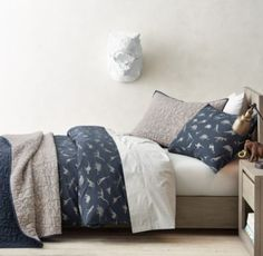 RH baby&child's Dinosaur Print & Vintage-Washed Percale Bedding Collection:Prehistoric dinosaurs are rendered on a soft and supple blend of cotton and linen. Its textural hand lends a relaxed look – and feels right at home in any young archeologist's room.