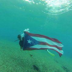 El Natural ,en Aguadilla Puerto Rico. photo by : Christian Hernández ... esto es evidencia. Para que vean que nuestra bandera ondea donde sea!  Dios bendiga a mi Puerto Rico y a mi gente linda .