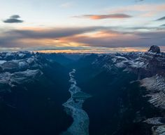 www.littlerugshop.com It felt like a view we were never meant to see. The direct result of a Glacier carving it's way between massive peaks.. Giving way to this perfect braided river.  At the end of the river.. Who knows really? Maybe it leads to the ocean.. For now just another golden sunset. by chrisburkard