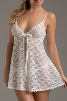 Peek with pleasure at this seductively sheer lace number. • Ivory Babydoll features a V-neckline, empire-waisted skirt and a satin bow • Paired with a matching G-String • Babydoll has adjustable straps • Made in the USA   Peek-a-Boo Lace Babydoll  by Hanky Panky. Clothing - Lingerie & Sleepwear Denver, Colorado