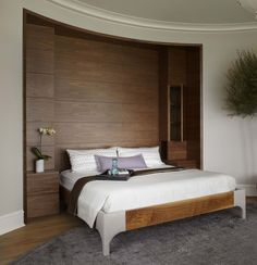Morgante Wilson Architects built in a custom walnut headboard with storage into this Master Bedroom.