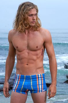 Sauvage Mens Swimwear - Azure Plaid - There are all sorts of fashion add ons in these Men Sauvage Plaid swim trunks, like a modern, fashionable low rise that will keep you looking fresh and young, as well as an equally fun and appealing high cut leg that will also keep you fashion forward and looking stylish. #designerswimwear