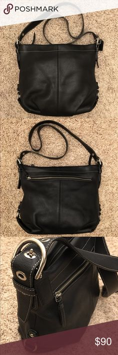 """Coach Leather Handbag F15064 Coach Crossbody handbag in black pebbled leather with light blue lining. Zip pocket on back exterior of bag. Two slip pockets and one zip pocket on interior of bag. Approximate dimensions: 9.5"""" x 11.5"""" x 3.5"""". Beautiful bag! I'm always happy to answer questions and to add more pics if you'd like! Coach Bags Crossbody Bags"""