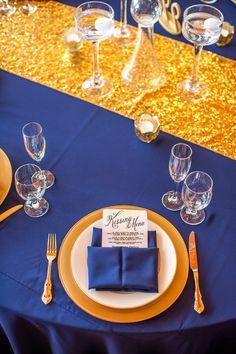 Trilogy at Vistancia Weddings | Navy and gold table setting featuring a Kissing Menu for a glam wedding | www.weddingsatvistancia.com | Drew Brashler Photography