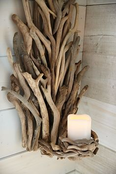 Bring the ocean inside with this stunner. Our driftwood sconce is a dramatic statement and a one-of-a-kind creation. Pair it with one of our scented pillars for even more atmosphere. A Pier 1 exclusive. Seaside Decor, Beach House Decor, Coastal Decor, Rustic Decor, Home Decor, Chandeliers, Pillar Candle Holders, Candleholders, Driftwood Furniture