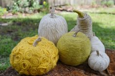 Yarn Wrapped Gourds.  Pretty sure the $1 store has yarn. Fun!