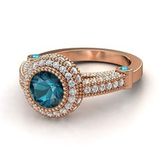 WOW. This is fricking gorgeous! Round London Blue Topaz 14K Rose Gold Ring with London Blue Topaz & Diamond | Vanessa Ring | Gemvara