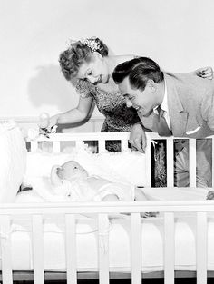 mariedeflor:  Lucille Ball and Desi Arnaz photographed at home with their baby daughter, Lucie (1951)