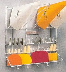Pastry wall rack {something like this would be *great* to have on a cupboard door for my cake decorating supplies!}