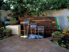 The crystal falls of this water feature wall, designed by Morgan Holt and Robin Stockton, sparkle with light, thanks to an underwater light hidden in the basin. Light play can be an important part of any landscape and add a whole new dimension to a yard. Reflections also play off the stacked-glass edge of the stone wall. Photograph by Rick Brazil