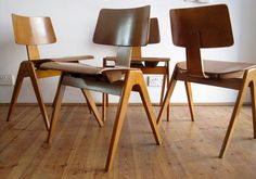 """Robin Day - England""""Hillestak"""" chairs for Hille. Beech frame and moulded plywood seat. Early versions with U-shaped dowelled leg joints c1950s."""
