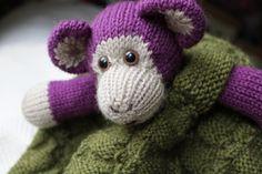 Ravelry: lindsaymudd's Green Blanket with Monkey .... who doesn't love a purple monkey?