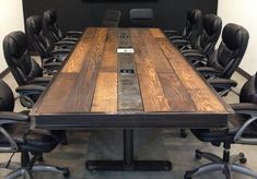 We built these conference room tables because we wanted a vintage/reclaimed feel but still look modern and industrial. The wood used is a treated douglas fir, so it has a the look of reclaimed wood, but is straight, smooth to write or lean on, and easier on the wallet. The metal used is raw steel.