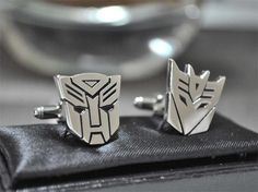 "The kid in me wants the Autobot cufflinks. The adult, Decepticon. The geek in me says ""Star Wars cufflinks, the obvious choice for you, mmmm."""