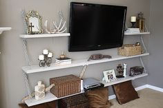 wall mounted tv, with accessories in baskets