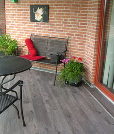 Covered balcony made ​​with vinyl strips. mFLOR Authentic