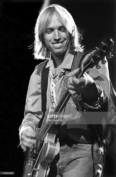 Tom Petty performs on stage with Bob Dylan at Ahoy, Rotterdam, Netherlands, 19th September 1987.