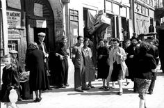 Warsaw ghetto, Poland, Jews next to a paint store. One of the photographs taken by the German photographer Willi George over the course of a single day in the summer of 1941. The photographs are unique in that they were not staged, but showed the ghetto as it truly was.