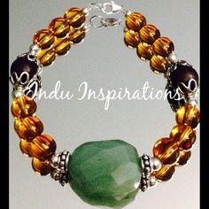 Amber, amazonite, wood jasper, and sterling silver bracelet on Etsy, $70.00
