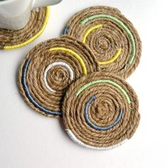 Learn how to create these nautical-inspired twine coasters! Could use clothesline as well.