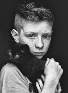 BW.......freckled boy n  black cat ...